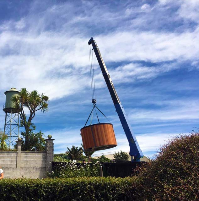 A little helping hand from Diack Bros Cranes swinging this hot tub into position on Napier Hill.